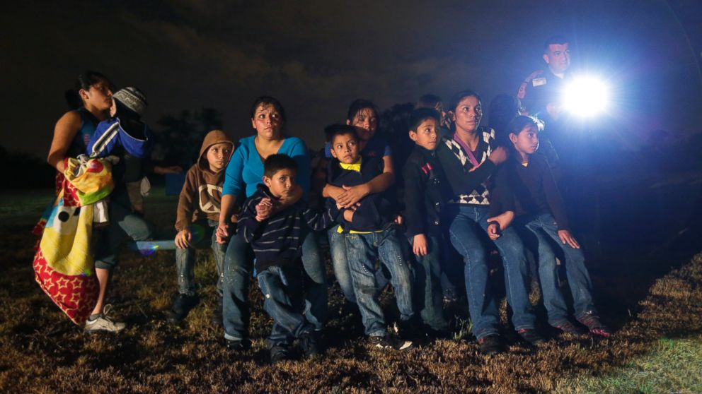 PHOTO: This June 25, 2014, file photo shows a group of immigrants from Honduras and El Salvador who crossed the U.S.-Mexico border illegally as they are stopped in Granjeno, Texas.