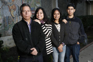 Ernesto Perez and his family are photographed in front of Our Lady of Guadalupe Church in San Jose, Calif., on Friday, Nov. 14, 2014. Standing left to