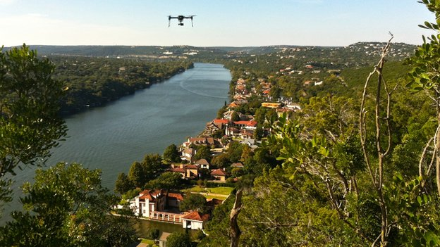 A 3D Robotics drone flying over a river