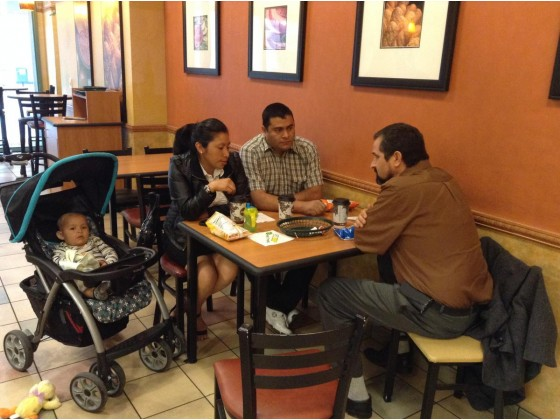 Daniel Guzman, legal-resources coordinator of Justice for Immigrants Coalition of Inland Southern California, in foreground, confers with Elva Marroquín and Angel Rosales at a Subway restaurant in downtown Los Angeles on March 11, 2015, before an immigration-court hearing involving two of the couple s children. Their U.S.-born baby, Emmanuel, is in the stroller.